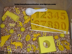 Teaching with an age gap, numbers and yellow sensory bin from Suzy Homeschooler